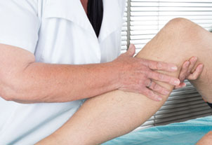 Therapist working with patient's knee